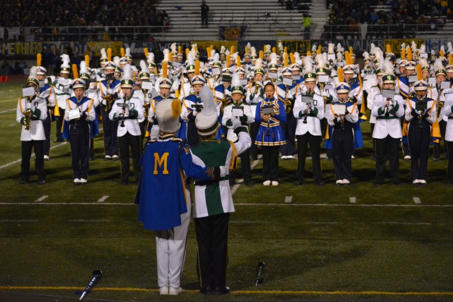 DHS & MHS marching bands combine on the field for halftime of the football game on Oct 23, 2015