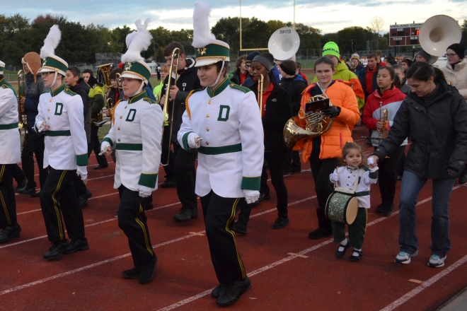 "DHS Marching Band followed into the stadium by their ""biggest"" fan as well as Jefferson 8th grade band members"