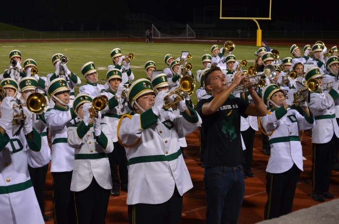 DHS Charger Marching Band with Alumni entertain the crowd after the homecoming game 9/25/15